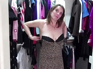 Shaved mature masturbates with toys on MatureNL
