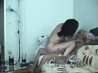 Young Indian prostitute riding on a mature man on the couch
