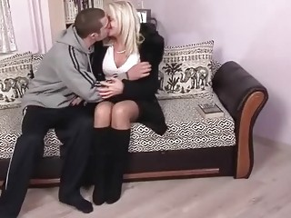 Blonde granny enjoying sex with young man