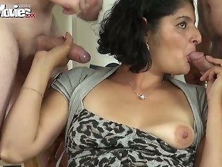 Dirty old bitch from India blows a couple of hard juicy penises