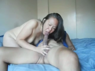 Mature Asian bitch sucks my dick and lets me fist her twat