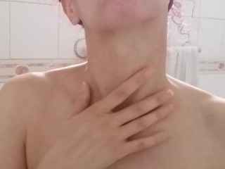 Close up down up sight of girl's stunning thick adam's apple in the bathroom