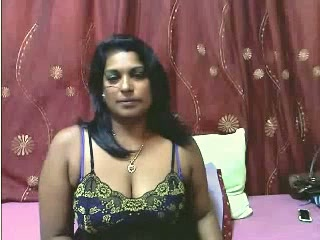 Sweet and busty mature Indian lady on webcam teasing