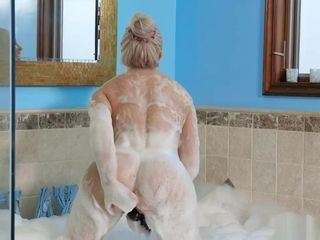 Brook Page playthings her cougar muff in a tub