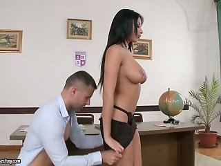 Buxom black haired MILF performs steamy deep throat in the office