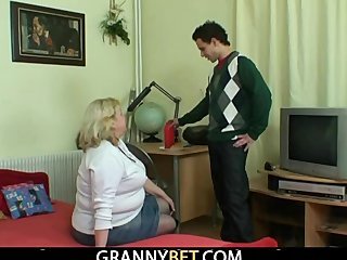 Grandma with huge melons enjoys riding cock