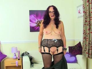 Brit grannie Zadi satiates her aged moist vagina