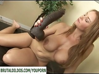 Busty milf with a huge brutal dildo