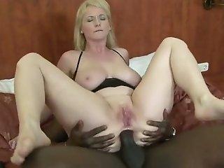 Bootyful blonde mom enjoys fervent interracial anal sex indoors
