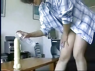 hubby films his wife  and helps her with a big toy (anal)