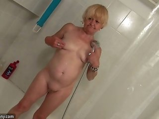 Ugly frightening blonde oldie takes a shower and teases her mature cunt
