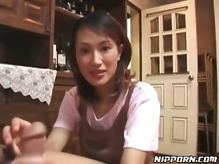 Lusty Japanese housewife jerks off and sucks tasty lollicock