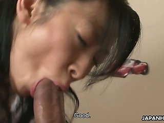 Young Japanese housewife Emiko Koike gives blowjob in 69 pose