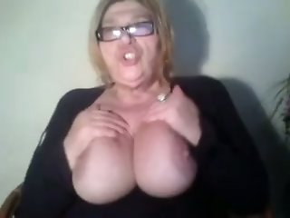 Mature blonde fattie plays with her tits and cunt in front of a webcam
