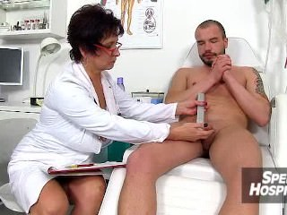 Stockings lady Marta wears uniform and milking young boy