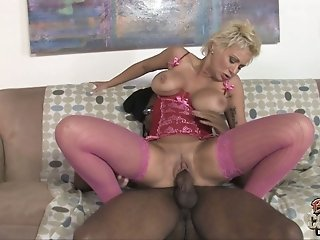 Blond mature whore in corset Isabella Rossa rides monstrous black cock hard