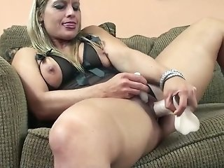 Curvy blonde mommy masturbates with a dildo on the couch