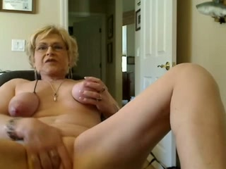 Perverted plump short haired blonde oldie enjoys fucking herself