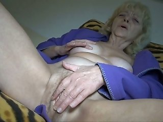 Short haired curly blonde old wanker fucks her mature cunt with toy