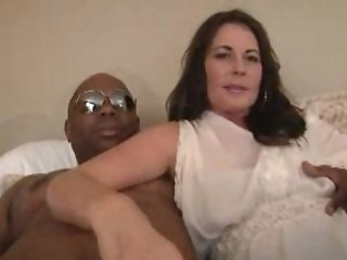 Super hot brunette mom sucks a BBC and welcomes it in her cunt