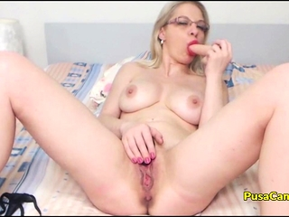 Inexperienced platinum-blonde mommy with Glasses Solo getting off