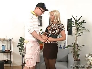 Young thirsting freak in glasses gives nice cunnilingus to busty blond MILF