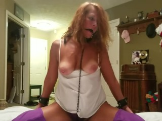 Mature Daizy Layne. Ball ball-gagged,trussed,palms & soles,twat shackled, band