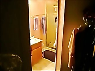 Hidden cam clip with my ex wife undressing and taking a shower
