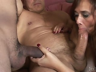 Horny and freaky wife deep throats hard penis of her man and his bisexual freak