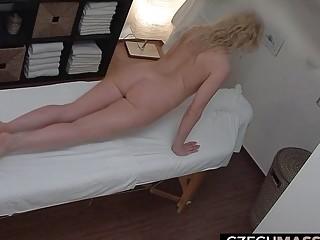 Blond cougar blows the massagist