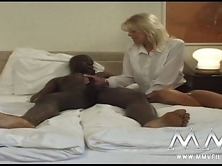 Bosomy blond haired hottie gets her kitty fucked in sideways pose by BBC