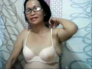 Mature Filipina in glasses shows her boobs and fingers her vagina