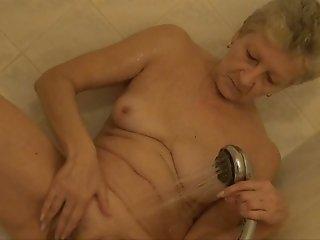 Old wrinkled short haired blondie Jitka masturbates mature cunt in shower