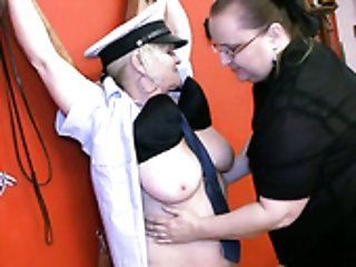 Tied up blonde old bitch in black stuff gets her mature cunt teased
